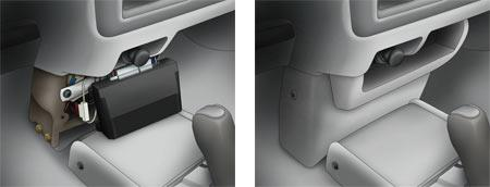 An alarm brain installed behind a center console panel