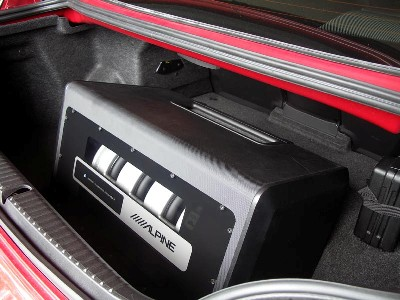 The trunk of the RX-8 has a depression and the ALPINE PLV-7 fit perfectly into it.
