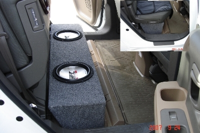 Subwoofer box under the rear seats