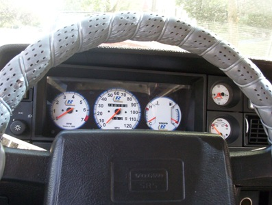 White gauges on a Volvo 240/><p class=