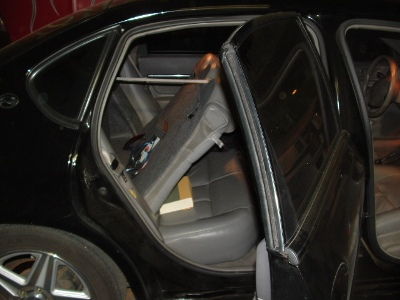 Mounted amp can be seen on backside of rear seat/><p class=
