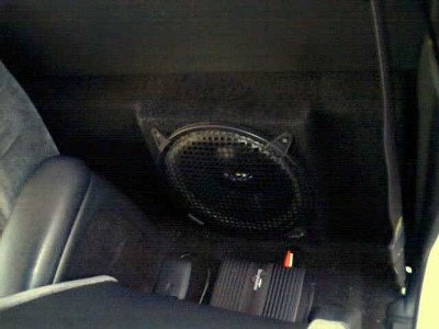 Amp and sub crammed into a standard cab (no leg room lost!)
