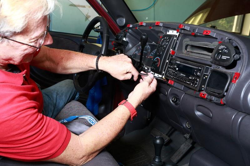 Gary removing factory radio from 2001 Ram