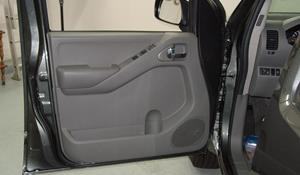 2009 Nissan Frontier XE Front door speaker location