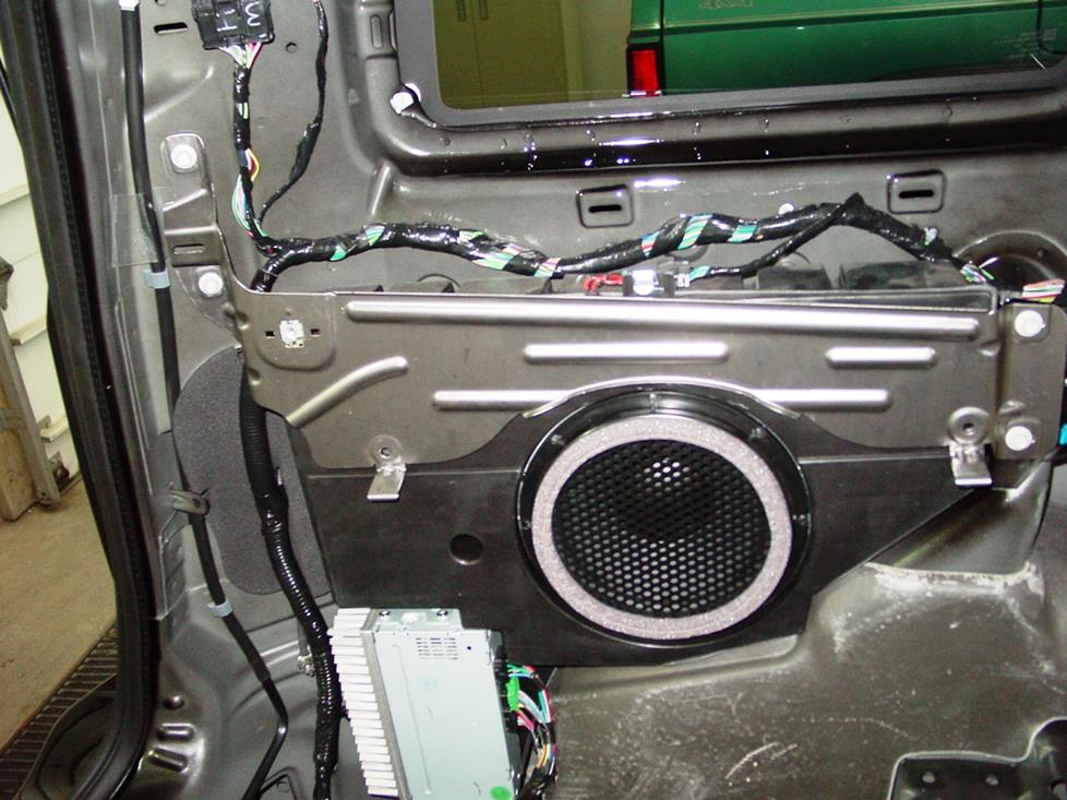 The factory subwoofer and amp (Crutchfield Research Photo)