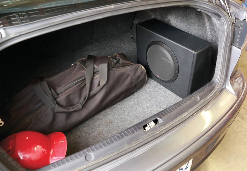 The Rockford Fosgate powered subwoofer mounted in the trunk