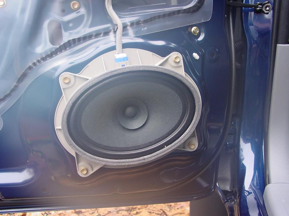 "The factory 6""x9"" speaker in its molded bracket (Crutchfield Research Photo)"