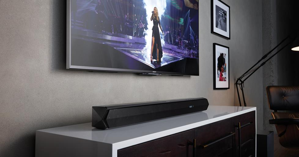 Wall mounted TV with sound bar on cabinet below