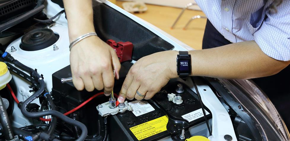 Attaching the power cable to the Subaru's battery.