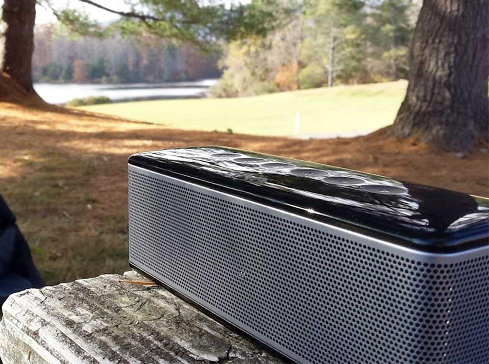 RIVA S portable Bluetooth speaker on a picnic