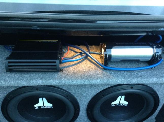 Brendan B's 2007 Chevrolet Impala with Kicker 43CXA600.1 amplifier and JL Audio 12W0V3 subwoofers in trunk