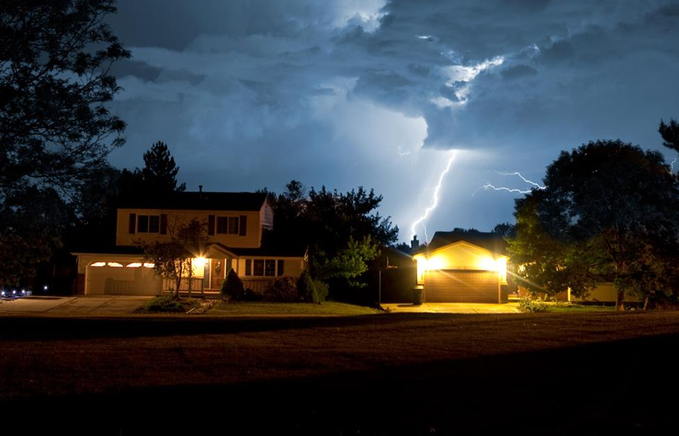 Lightning striking near house