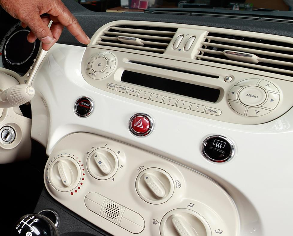 The Fiat's factory radio and dash console