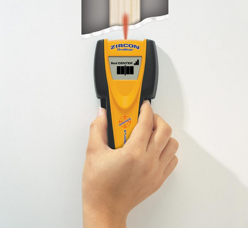 Photo of stud finder being used.