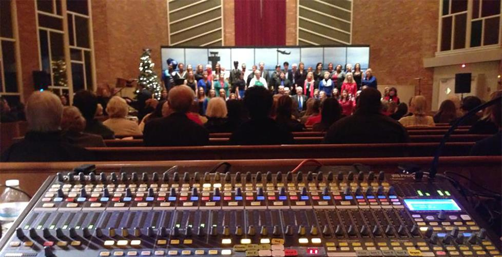 mixing board in a church with choir singing