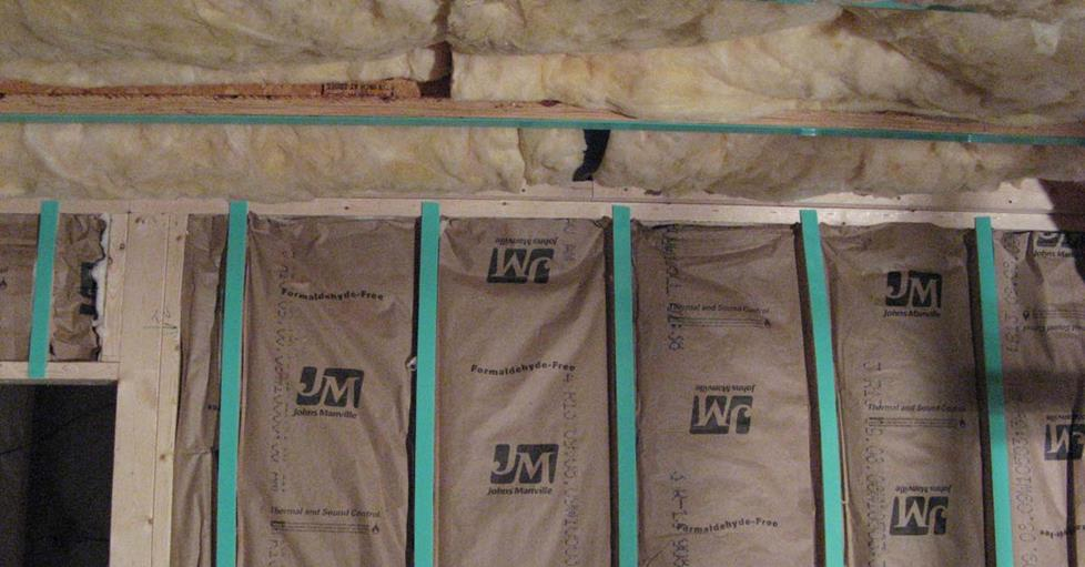 Framed wall, with insulation and foam tape