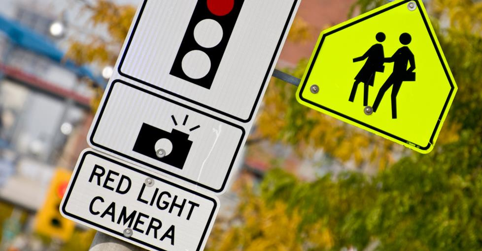 Red light camera sign on a street