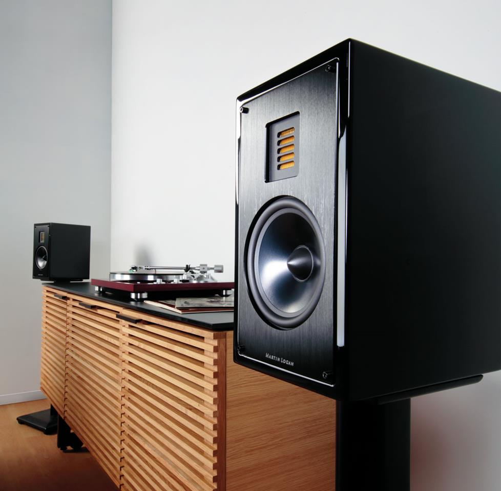 Martin Logan speakers on stands with a turntable