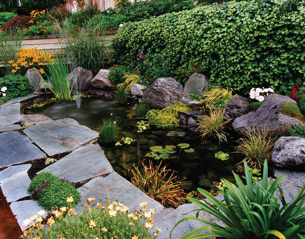 Rock speakers in landscaping