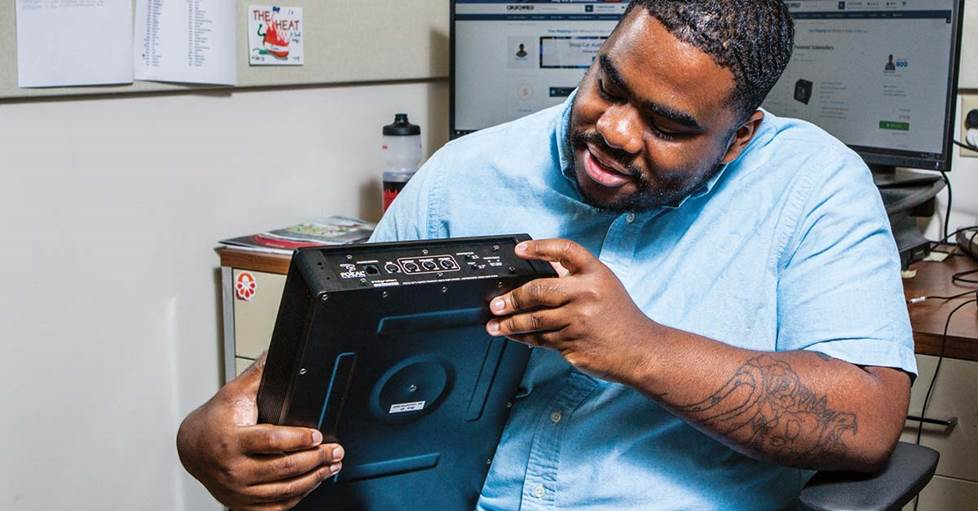 Cam examining the Focal iBus 20 compact powered subwoofer
