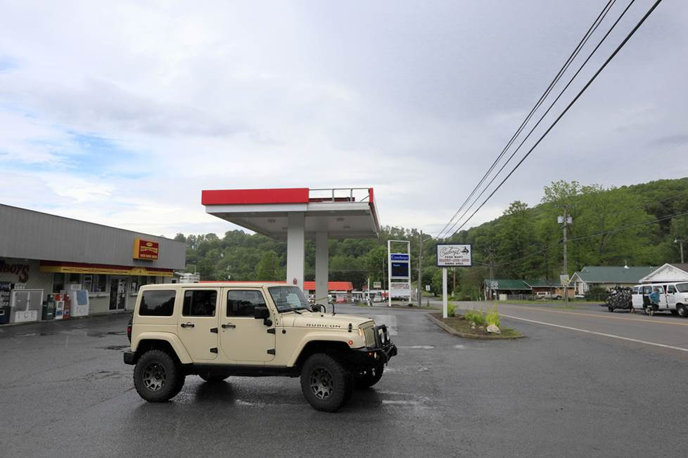 Starting the journey at a gas station on a cloudy day.