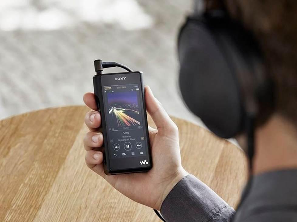 person using a portable high-res music player