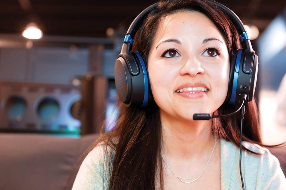 Woman wearing gaming headphones