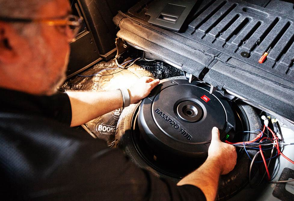 Installing his JBL BassPro Hub in the trunk of his car