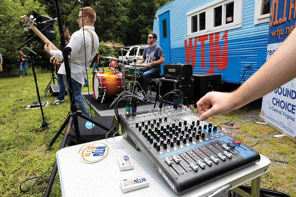Adjusting mixer at outdoor concert