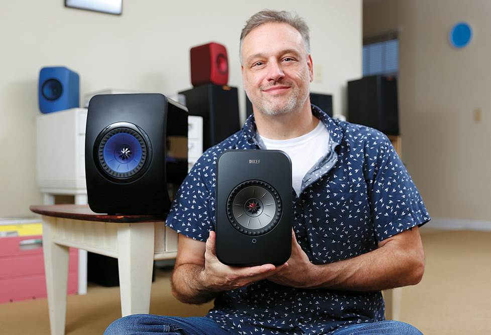 Eric showing the relative sizes of the speakers.