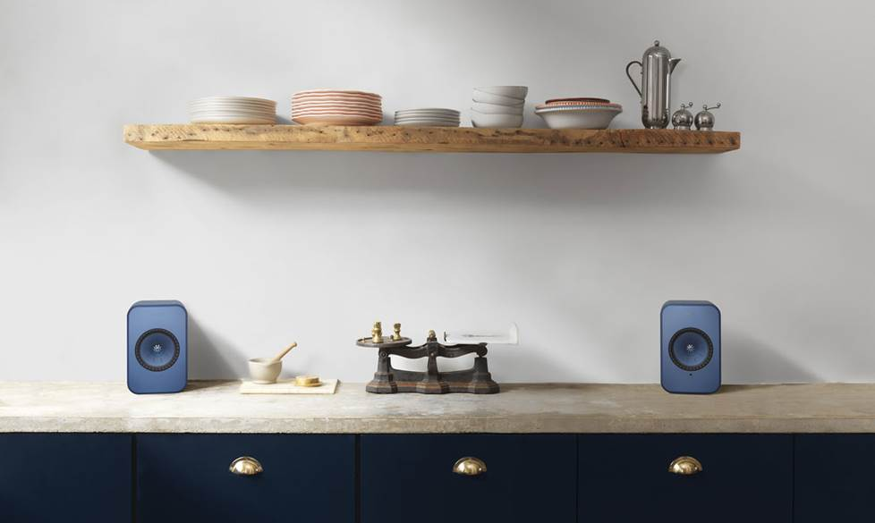 KEF speakers on a counter.