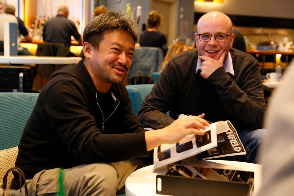 Jeffrey Miller and Tomoaki Sato looking at an old Crutchfield catalog