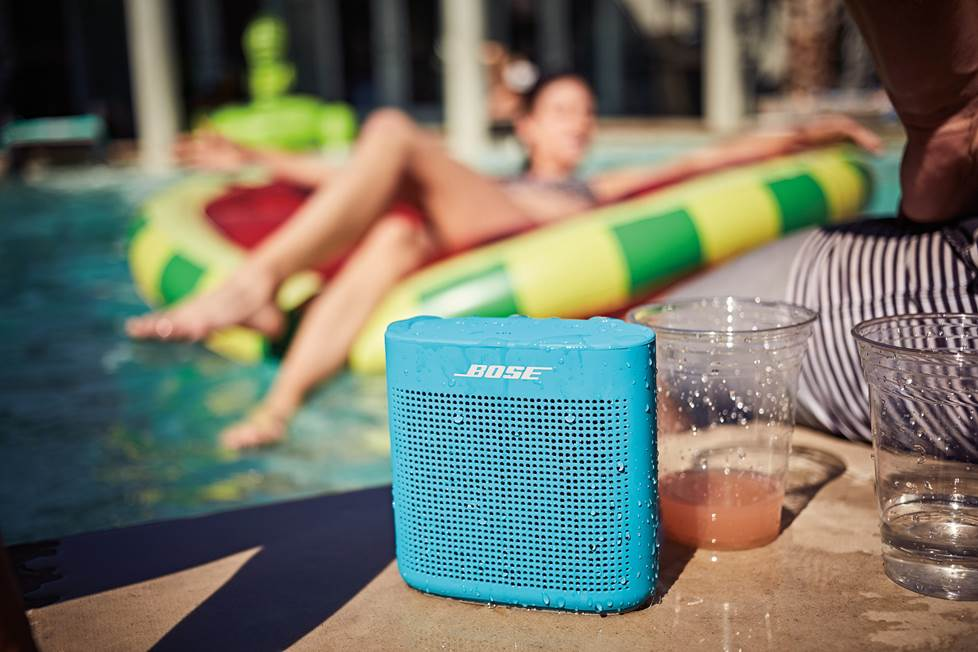 Bose soundlink 2 portable bluetooth speaker sitting by the pool.