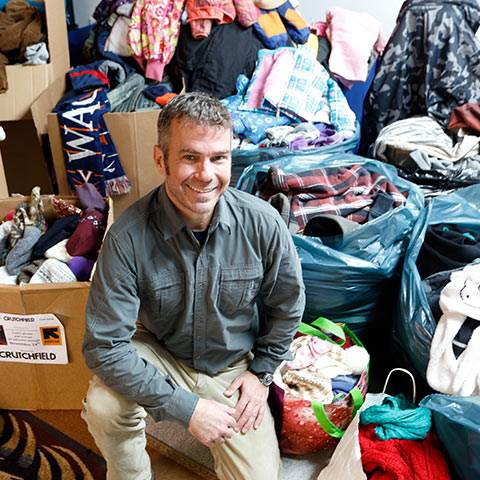 We're all about employee-driven initiatives at Crutchfield, like Tommy's annual coat drive for local families in need.