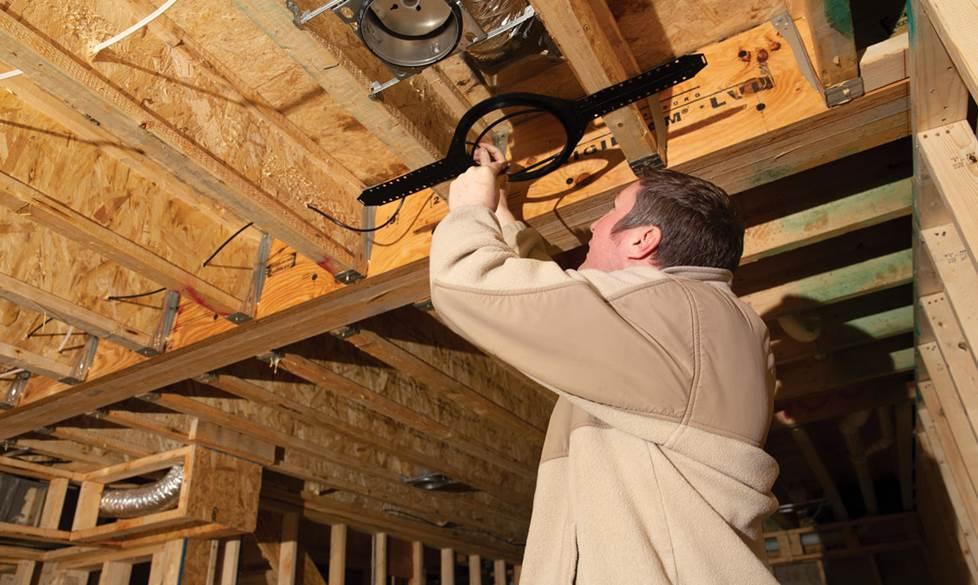 Mark installing a ceiling bracket.