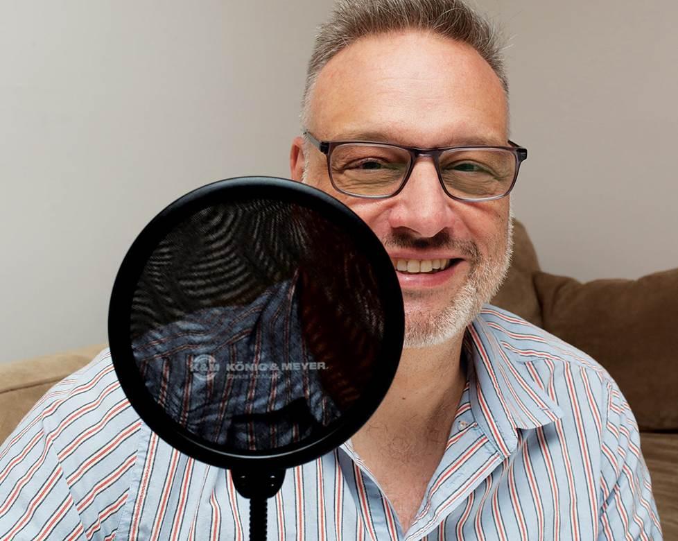 Man with mic pop filter