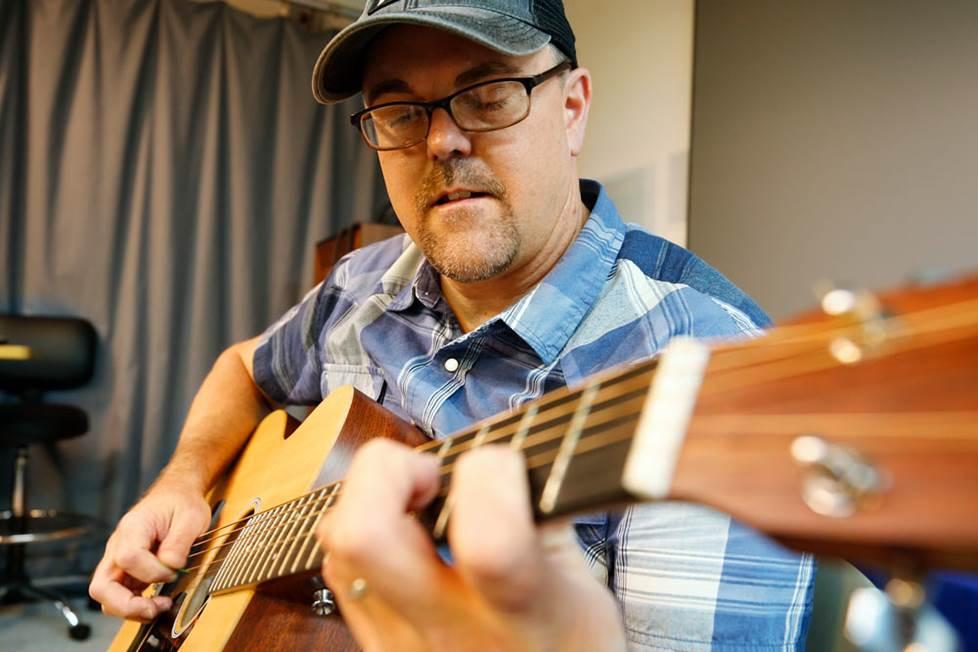 Rex with guitar