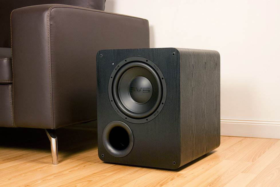 SVS subwoofer next to couch