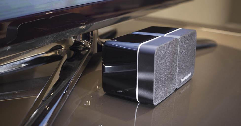 Cambridge Audio's Minx Min 22, an ultra-compact speaker, sitting under a TV