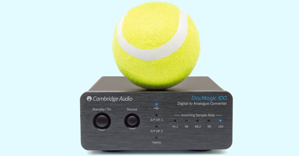 Cambridge Audio DacMagic 100 with a tennis ball for scale.
