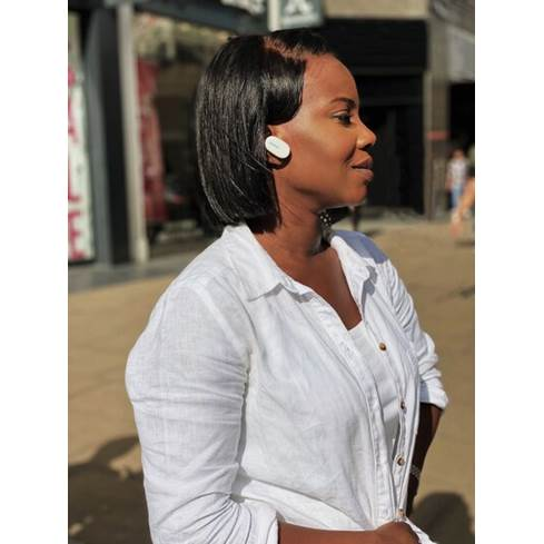 Woman wearing the Bose QC earbuds