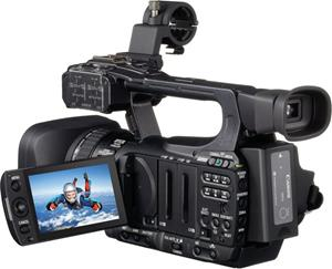 The Canon XF100, with the LCD display deployed