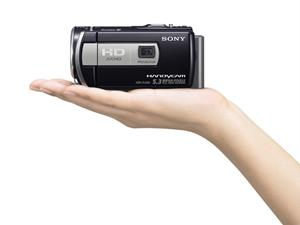 The Sony Handycam® HDR-PJ200 in hand for scale