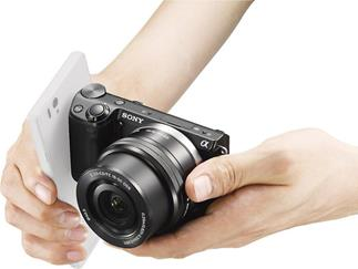 Just a quick tap initiates the Sony Alpha NEX-5T's communication via NFC (smartphone and lens not included)