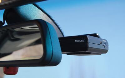 Escort SmartRadar radar detector behind rear-view mirror