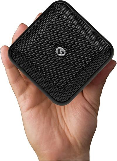 Boston Acoustics SoundWare XSSE satellite speaker in hand