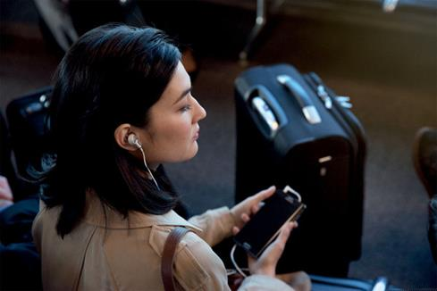 Woman wearing QC20 headphones