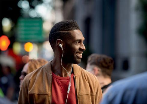 image of man wearing Bose QuietComfort 20i headphones