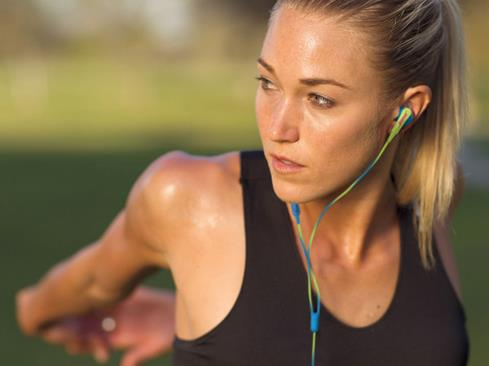 woman wearing the Bose SoundSport in-ear headphones