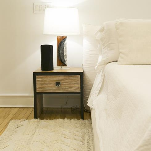 The HEOS 3 HS2 speaker plugs in for power, and can be positioned vertically or horizontally.